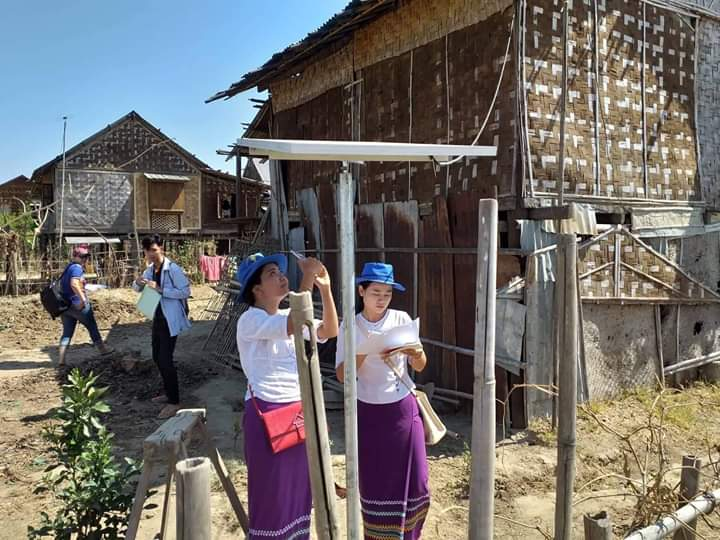 Rural Development Department staff inspect the installation of solar panel system at a village in Pyapon Township. Photo: Soe Moe Kyaw