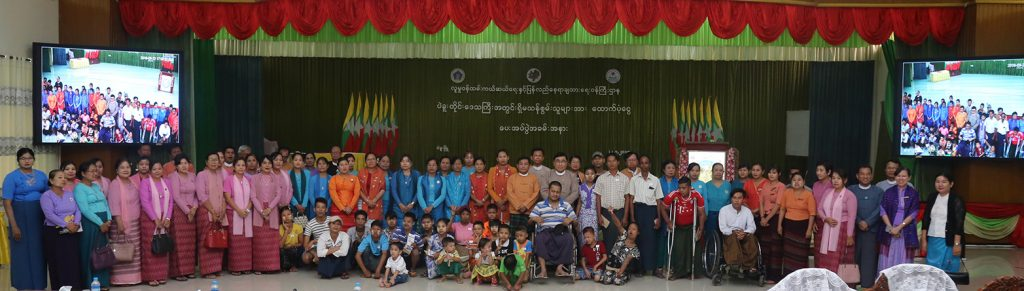 Union Minister Dr Win Myat Aye and officials pose for a group photo with persons with disabilities at Bago City Hall in Bago yesterday.  Photo: MNA