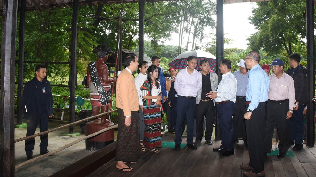 Vice President U Henry Van Thio visits the traditional house of Chin ethnic people at the Union National Races Village in Yangon yesterday. Photo: MNA