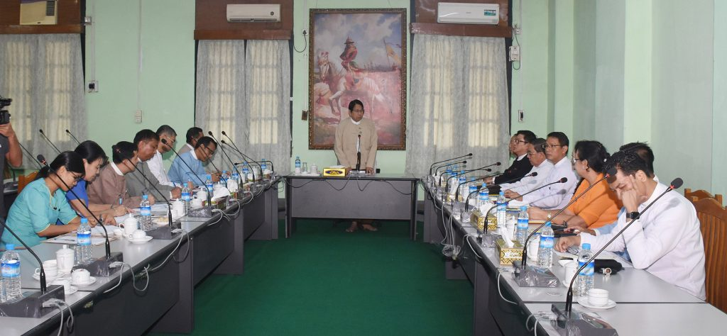 Union Minister Dr Pe Myint delivers the address at the meeting with personnel from Myanmar Newspaper Publishers and Rotary Press Business Owner Association in Yangon yesterday.Photo: MNA