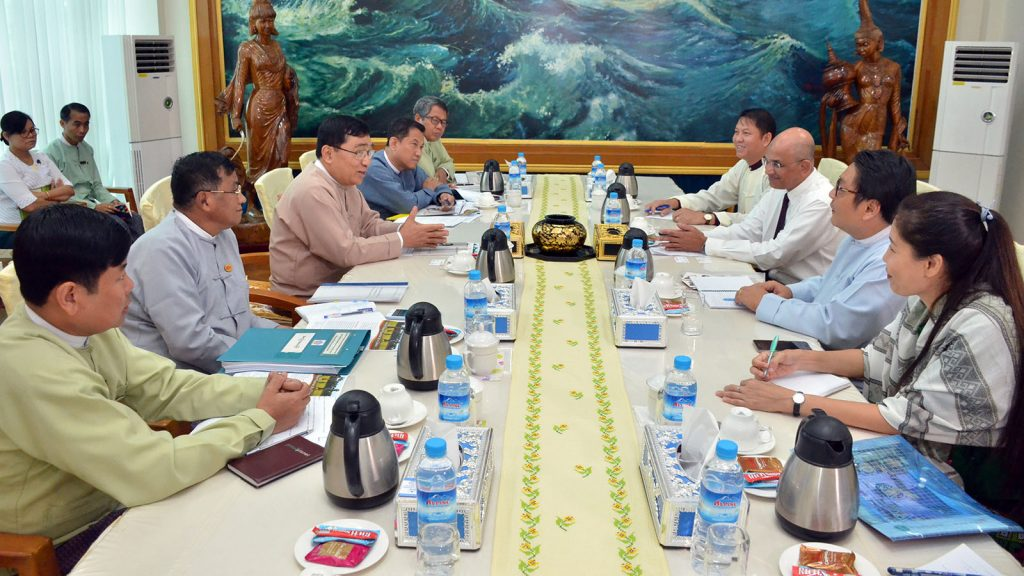 Union Minister Dr Win Myat Aye holds talks with a delegation from World Vision International Myanmar at the office of the Ministry of Social Welfare, Relief and Resettlement in Nay Pyi Taw yesterday. Photo: MNA