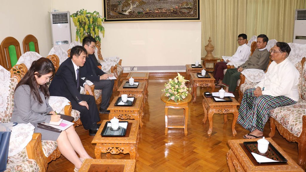 Union Commerce Minister Dr Than Myint holds talks with South Korean Ambassador Mr Lee Sang-hwa at his ministry. photo: mna