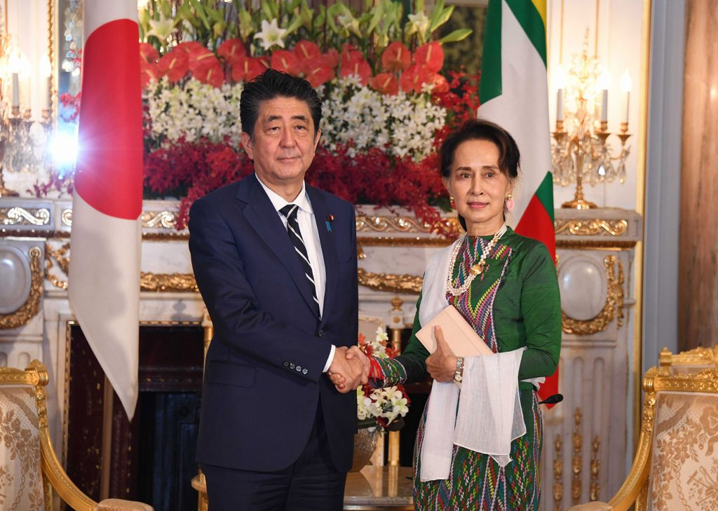 State Counsellor Daw Aung San Suu Kyi shakes hands with Prime Minister of Japan Mr Shinzo Abe at the State Guest House in Tokyo, Japan yesterday. Photo: MNA