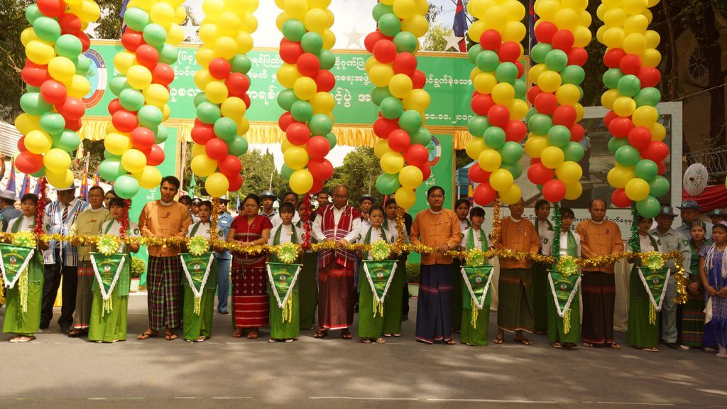 Amyotha Hluttaw Speaker Mahn Win Khaing Than, Kayin State Hluttaw Deputy Speaker Nan Thuzar Win, Hluttaw representatives and officials cut the ceremonial ribbon to open the new concrete road in Myawady, Kayin State yesterday. Photo: Htain Lin Aung