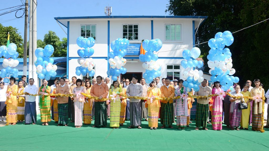 Union Minister Dr Pe Myint, Ayeyawady Region Chief Minister U Hla Moe Aung and dignitaries open the Community Centre at the Information and Public Relations Department in Ngathaingchaung.Photo:MNA