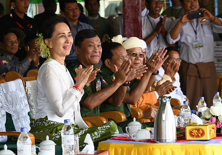 State Counsellor Daw Aung San Suu Kyi observes the Intha traditional boat race at the Inle lake in Northern Shan State yesterday.  Photo: MNA