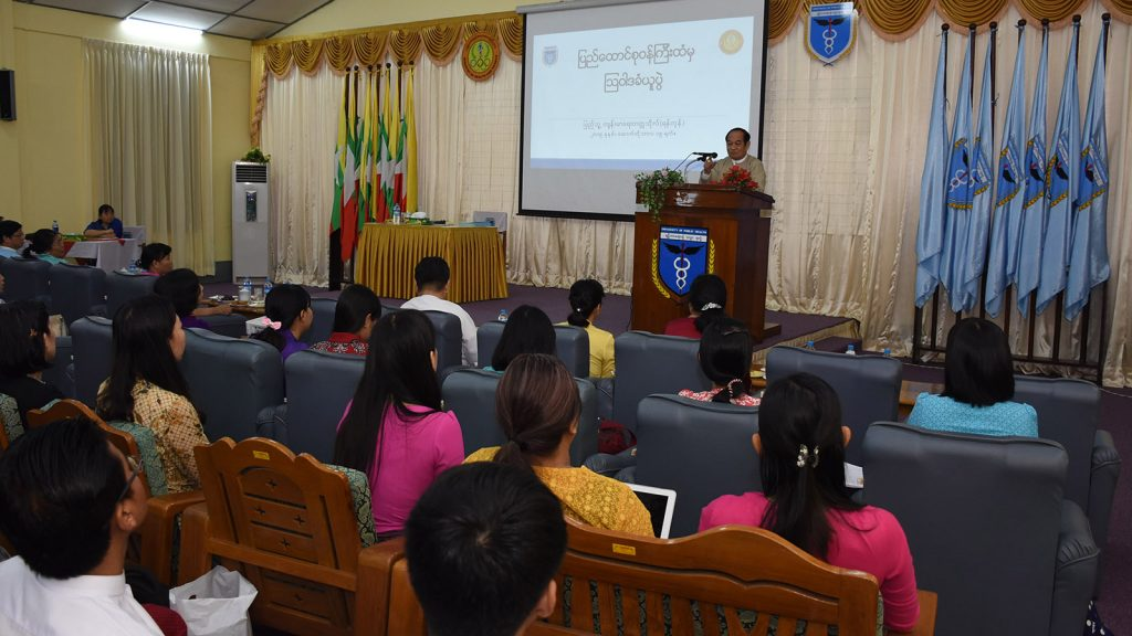 Union Minister for Health and Sports Dr Myint Htwe delivers the speech at the meeting with medical experts at the University of Public Health in Yangon yesterday.Photo: MNA