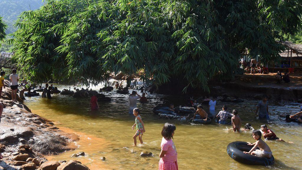 People enjoy their Thadingyut holiday at the creek in Aung Myin Thar Sanpya village. Photo: Htein Nan Naw