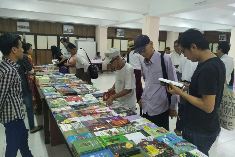 Bookworms are seen at the book stall at the Shwe Udaung Hall of the NPE in Yangon.Photo: MNA