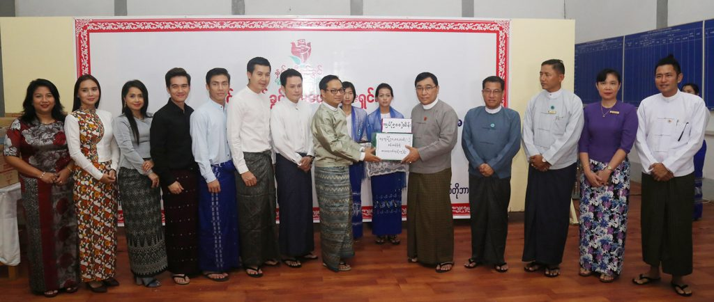 Union Minister Dr Win Myat Aye accepts cash K 50 million and the foodstuffs worth over K 9.8 million donated by the Hnin Si Yin Kwin Foundation for disaster-hit people yesterday.Photo: mna
