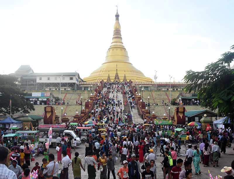 Buddhist devotees are seen at the Uppatasanti Pagoda on the Abhidhamma Day yesterday. Photo: Michael Htan
