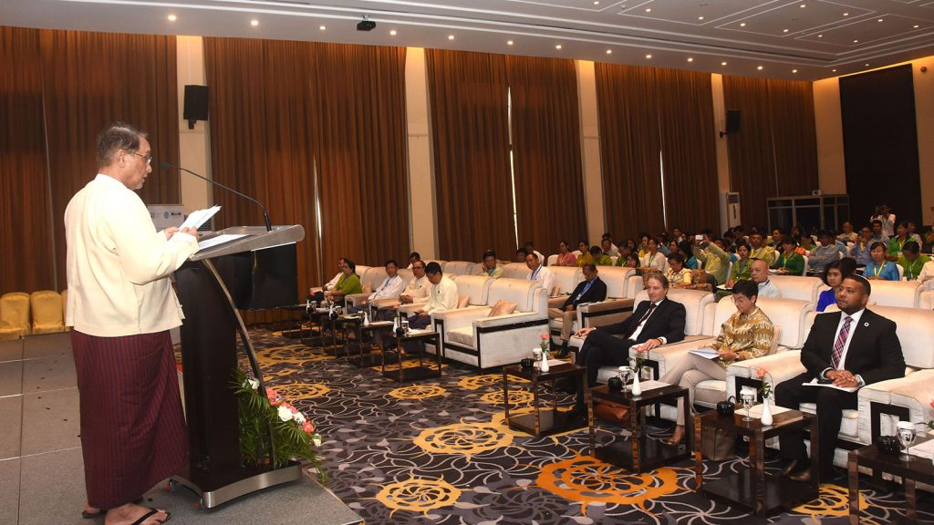 Union Minister Dr Than Myint gives the opening speech at the launching ceremony of ARISE Plus Myanmar Trade-Related Assistance Project in Nay Pyi Taw. Photo: MNA