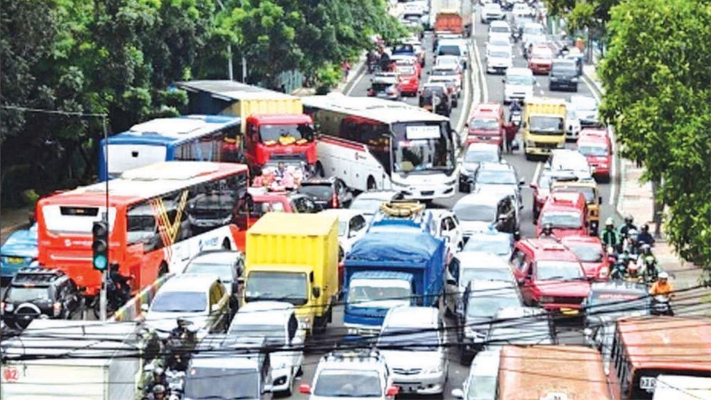 Cars get stuck in a traffic jam on the road.