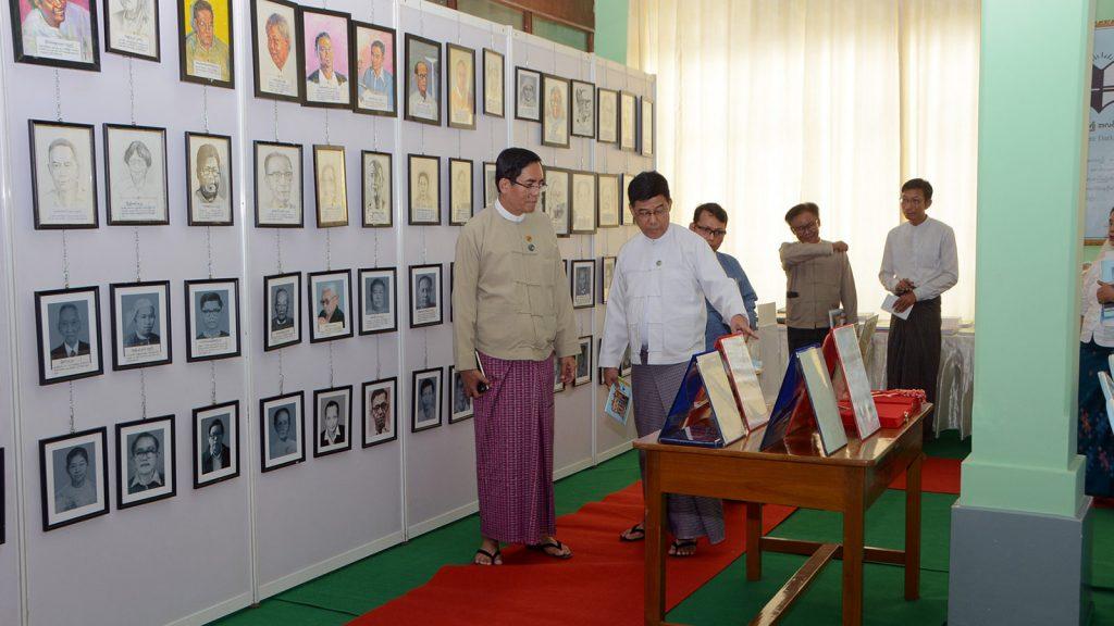 Deputy Minister for Information U Aung Hla Tun observes inside the Sarpay Beikman Building on Merchant Street, Yangon.photo: mna