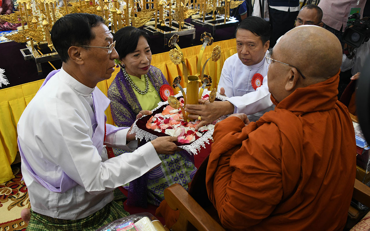 Union Election Commission Chairman U Hla Thein and wife offer religious objects to a Sayadaw.Photo: MNA