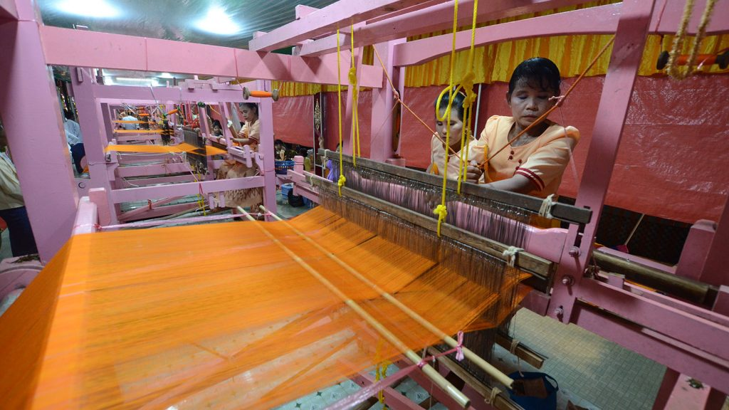 Women weaving of Matho Thingan (robe) at the Botahtaung Pagoda, Yangon yesterday. Photo: Phoe Khwar