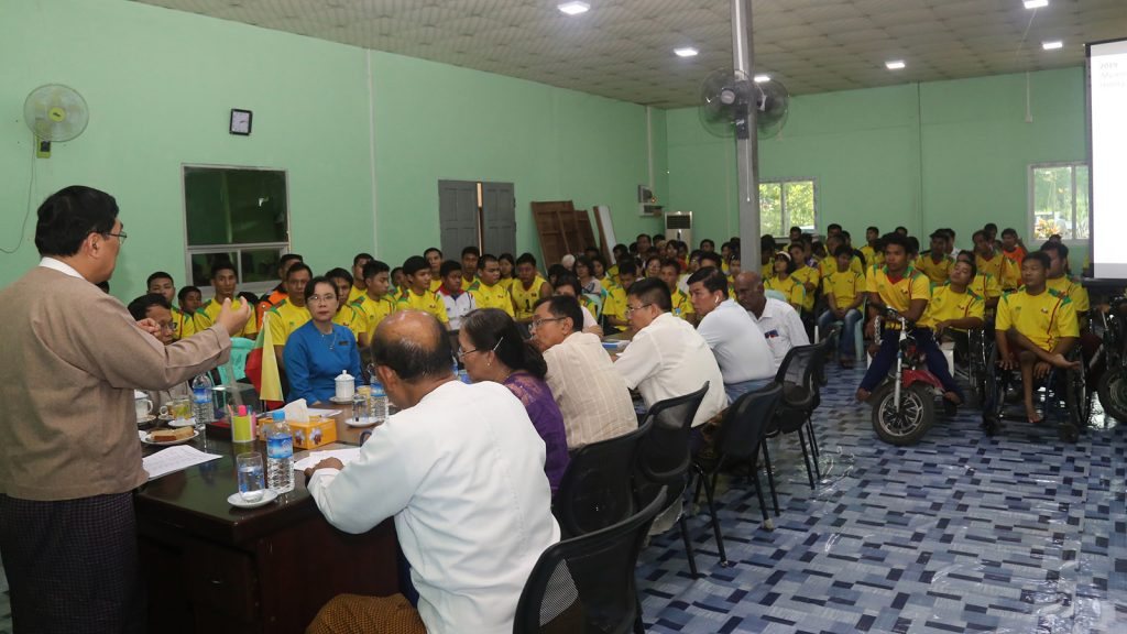 Union Minister Dr Win Myat Aye delivers the speech at the meeting of working committee for rights of disabled persons, athletes with disabilities in Yangon yesterday.Photo: MNA