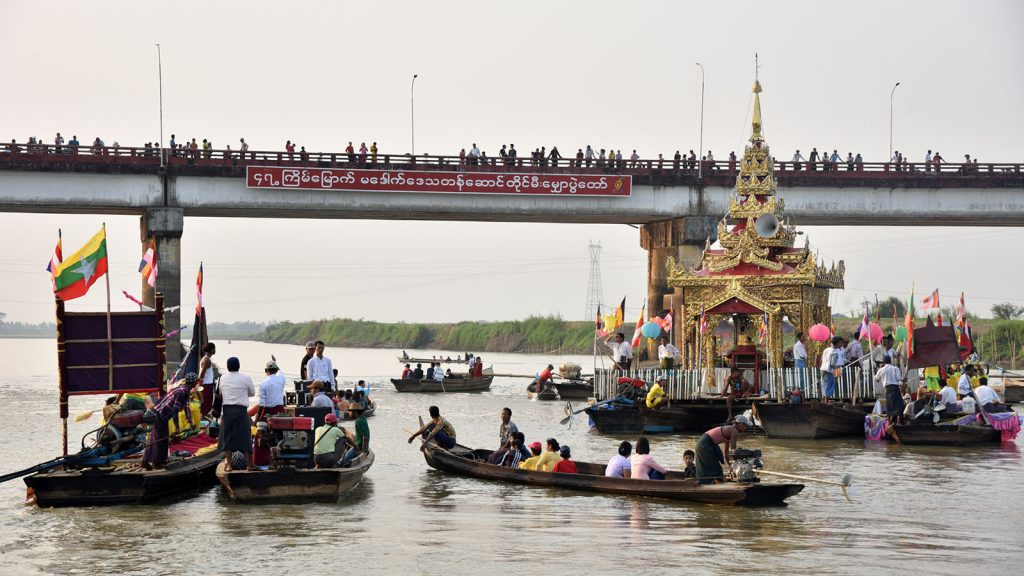Local people seen on boats to float paper lamps along the Sittoung River during light festival in Madauk.Photo: Ye Thein