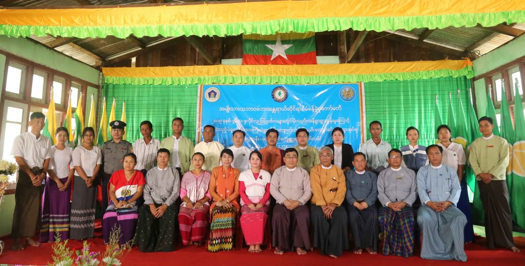 Union Minister Dr Win Myat Aye and officials pose for a group photo at the opening ceremony of the four-day course of training for trainers to conduct grading and registration of persons with disabilities in Nyaunglebin yesterday. Photo: mna
