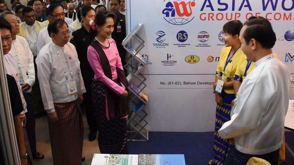 State Counsellor Daw Aung San Suu Kyi observes the booth displayed at the UMFCCI Centennial exhibition in Nay Pyi Taw yesterday.Photo: MNA
