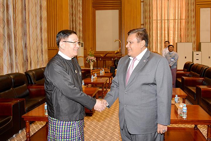 Pyithu Hluttaw Speaker U T Khun Myat shakes hands with Malaysian Ambassador Mr Zahairi Baharim in Nay Pyi Taw yesterday. Photo: MNA