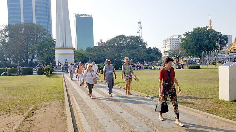 Tourists walk around at Maha Bandoola Park.  Photo: Ye Htit tin (NLM)