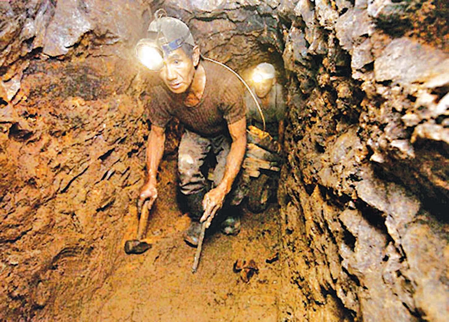 Underground mining workers work in a tunnel. Photo: Supplied
