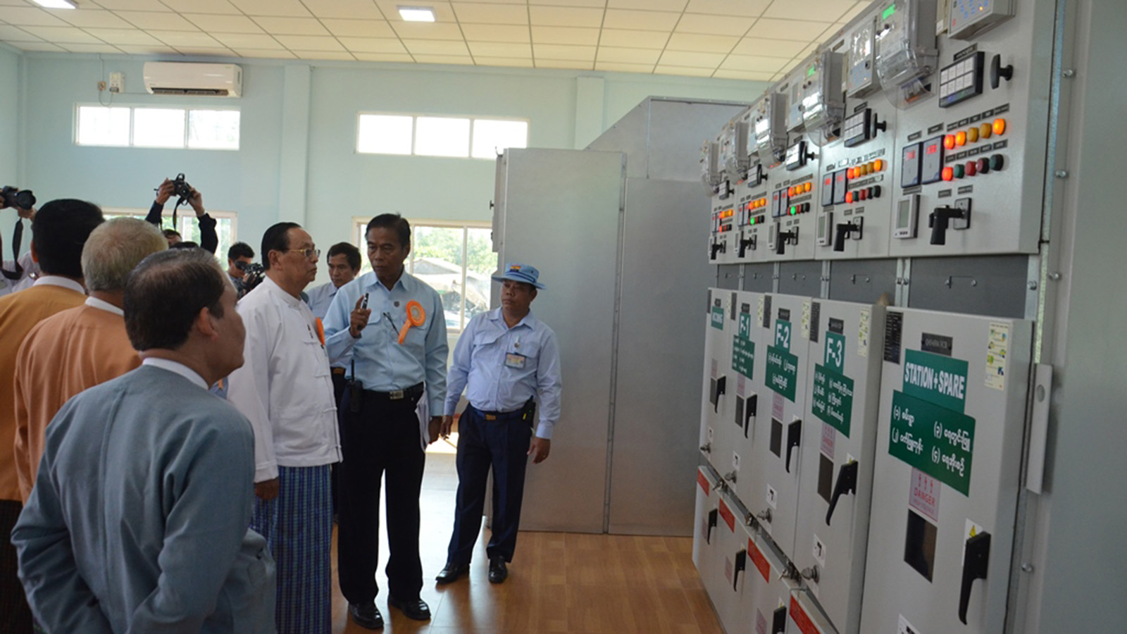 Union Minister U Win Khaing inspects the setting of the sub-stations yesterday.Photo: MNA