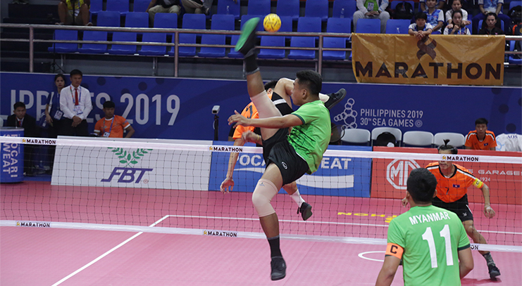 Myanmar and Laos players compete in the men's doubles Sepak takraw competition at the 30th SEA Games yesterday at the Subic Bay Gymnasium in the Philippines.Photo: SPED