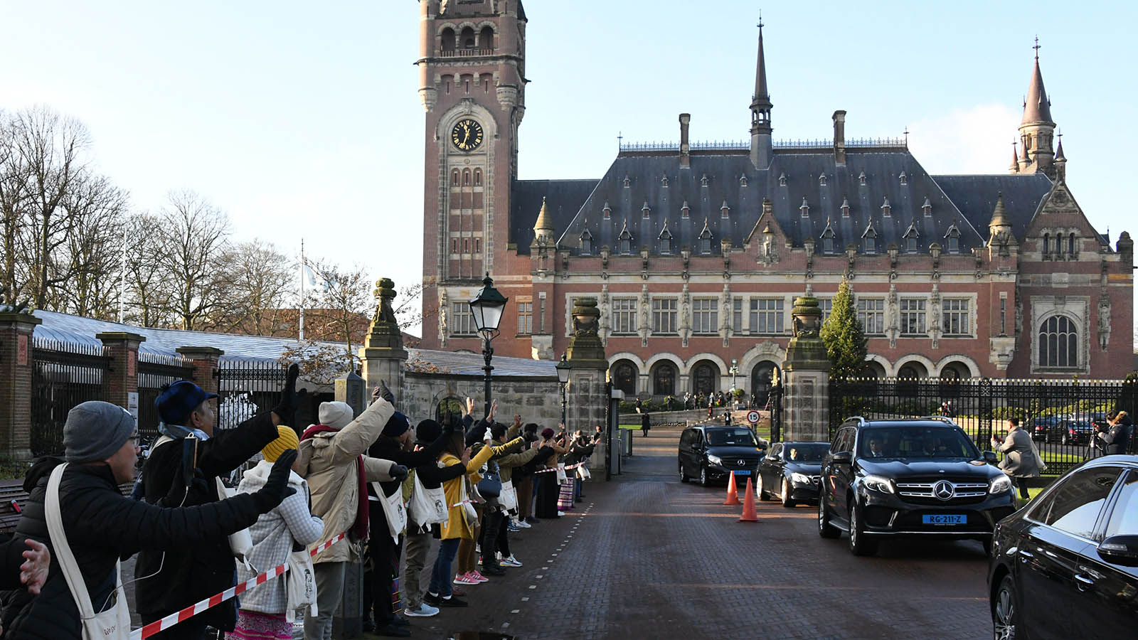 People greet State Counsellor and Union Minister for Foreign Affairs Daw Aung San Suu Kyi while she leaves the Peace Palace of The Hague at the International Court of Justice (ICJ) on the third day of The Gambia against Myanmar at The Hague, The Netherlands. Photo: Tha Byaw  (News on page-1)