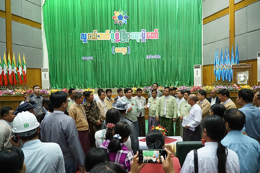 Magway Region Chief Minister Dr Aung Moe Nyo inspects the preparations for all-round youth  development festival at the Magway University in Magway yesterday. Photo: Than Naing Oo (Ngaphe)