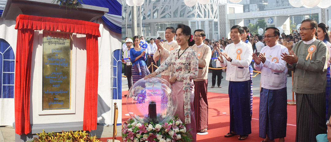 State Counsellor Daw Aung San Suu Kyi formally opens the two housings for university teachers and a new laboratory equipment factory in Hline Township, Yangon, yesterday.Photo: MNA