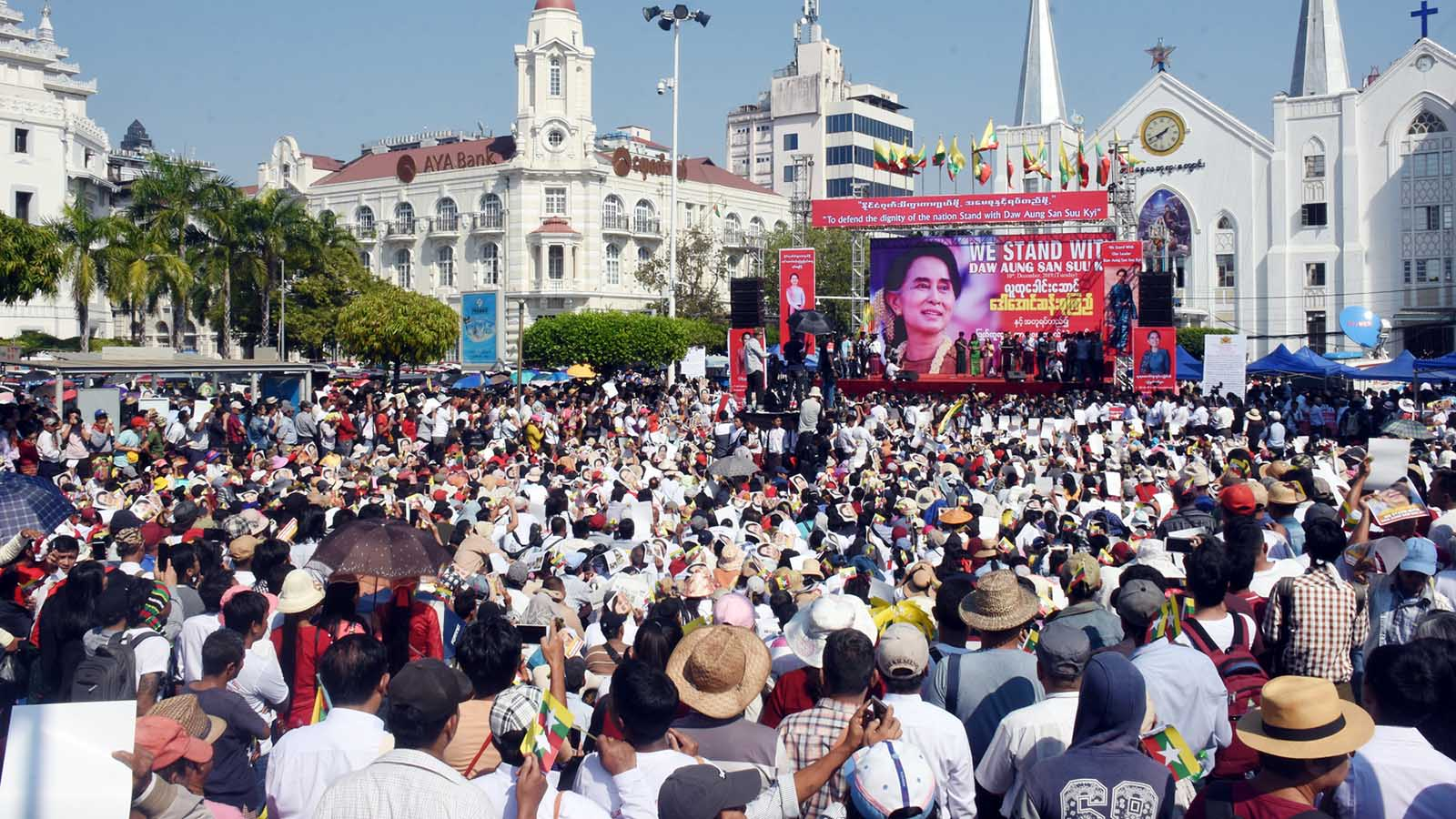 People participate in a rally in support of State Counsellor Daw Aung San Suu Kyi in downtown Yangon yesterday.Photo: Zaw Min Latt