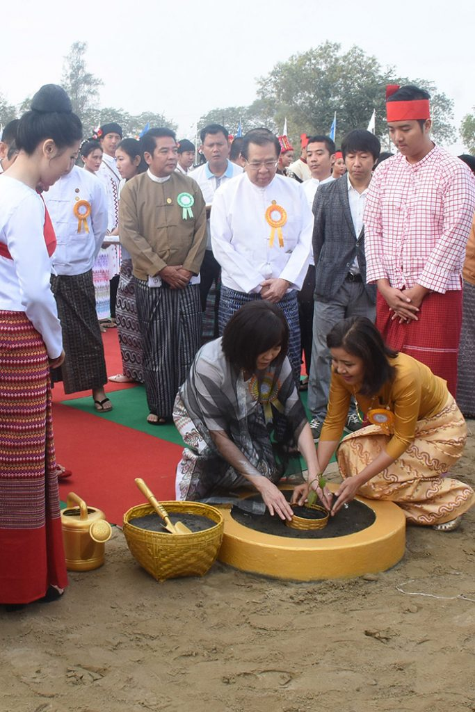 Mrs Akie Abe, wife of Japanese Prime Minister Shinzo Abe, planting a cherry tree at the the stake driving ceremony of the Shin Rai International Vocational Institute in Yangon yesterday.Photo: MNA