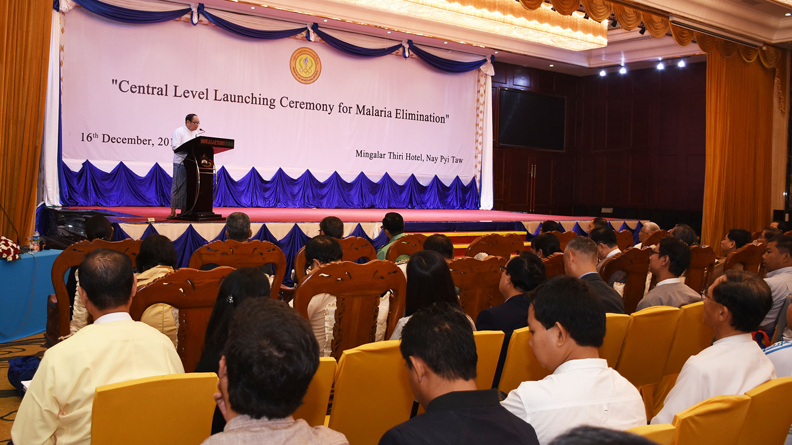 """Union Minister Dr Myint Htwe delivers a speech at the """"Central Level Launching Ceremony for Malaria Elimination"""" at the Mingalar Thiri Hotel, Nay Pyi Taw, yesterday.photo: MNA"""
