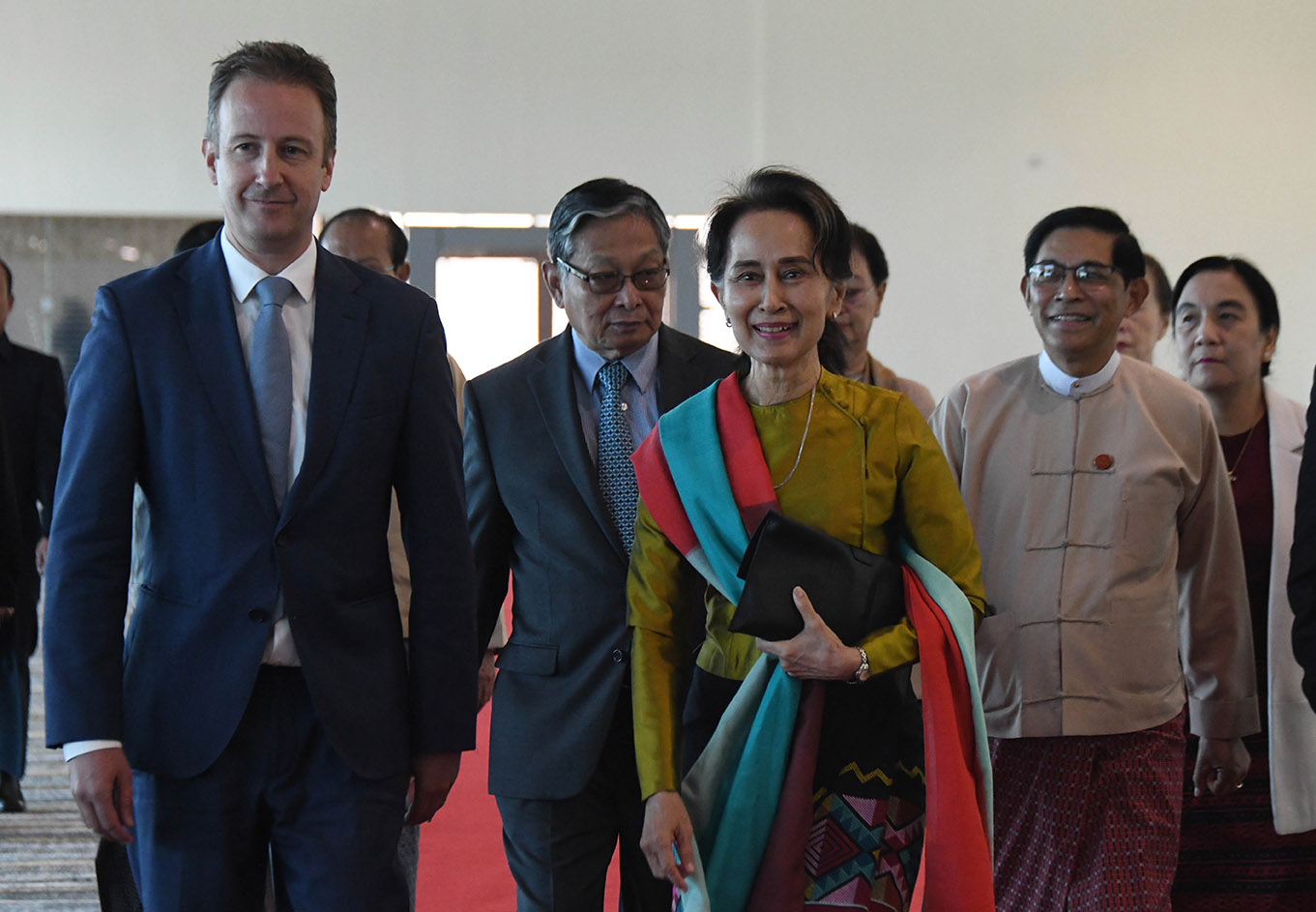 State Counsellor Daw Aung San Suu Kyi being seen off by Union Minister U Min Thu, officials and Ambassador of the Embassy of the Kingdom of the Netherlands in Myanmar Mr Wouter Jurgens at the Nay Pyi Taw International Airport yesterday. Photo: MNA