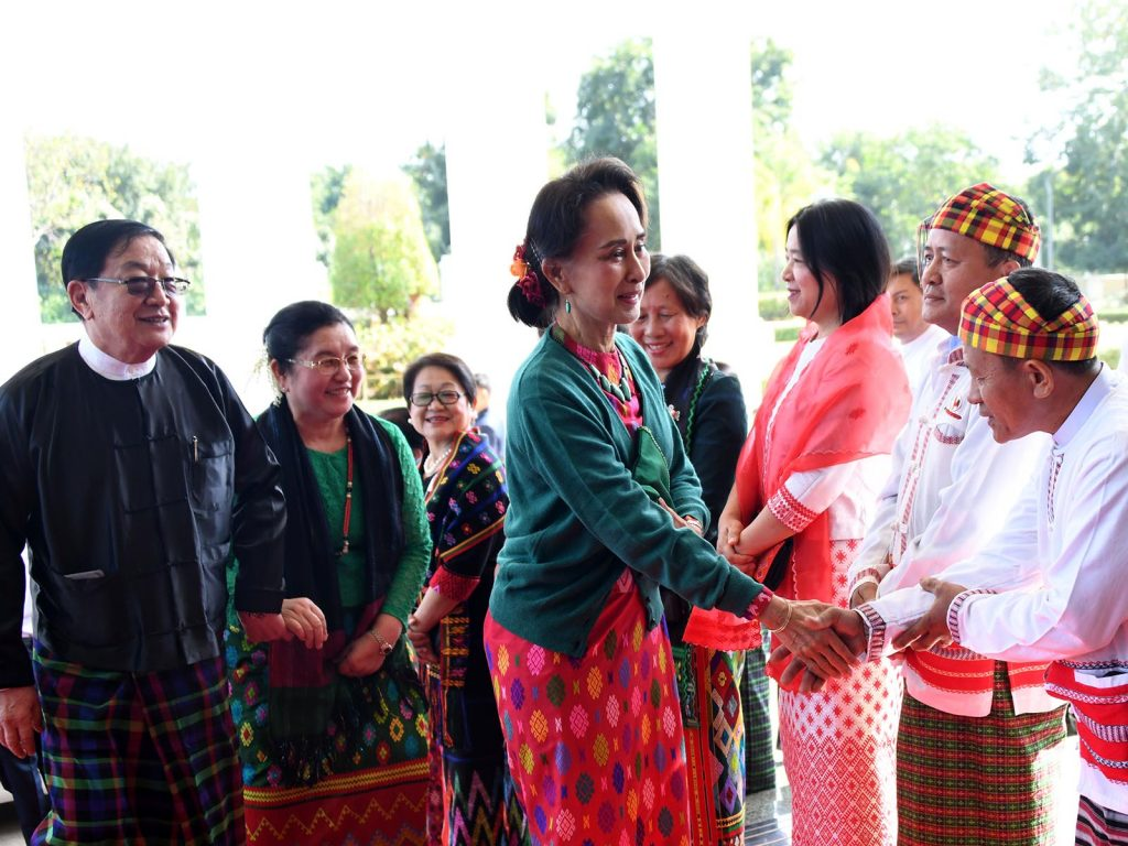 State Councellor Daw Aung San Suu Kyi being welcomed by Pyithu Hluttaw Speaker U T Khun Myat, wife and family members at the Christmas, New Year Eve luncheon. Photo: MNA