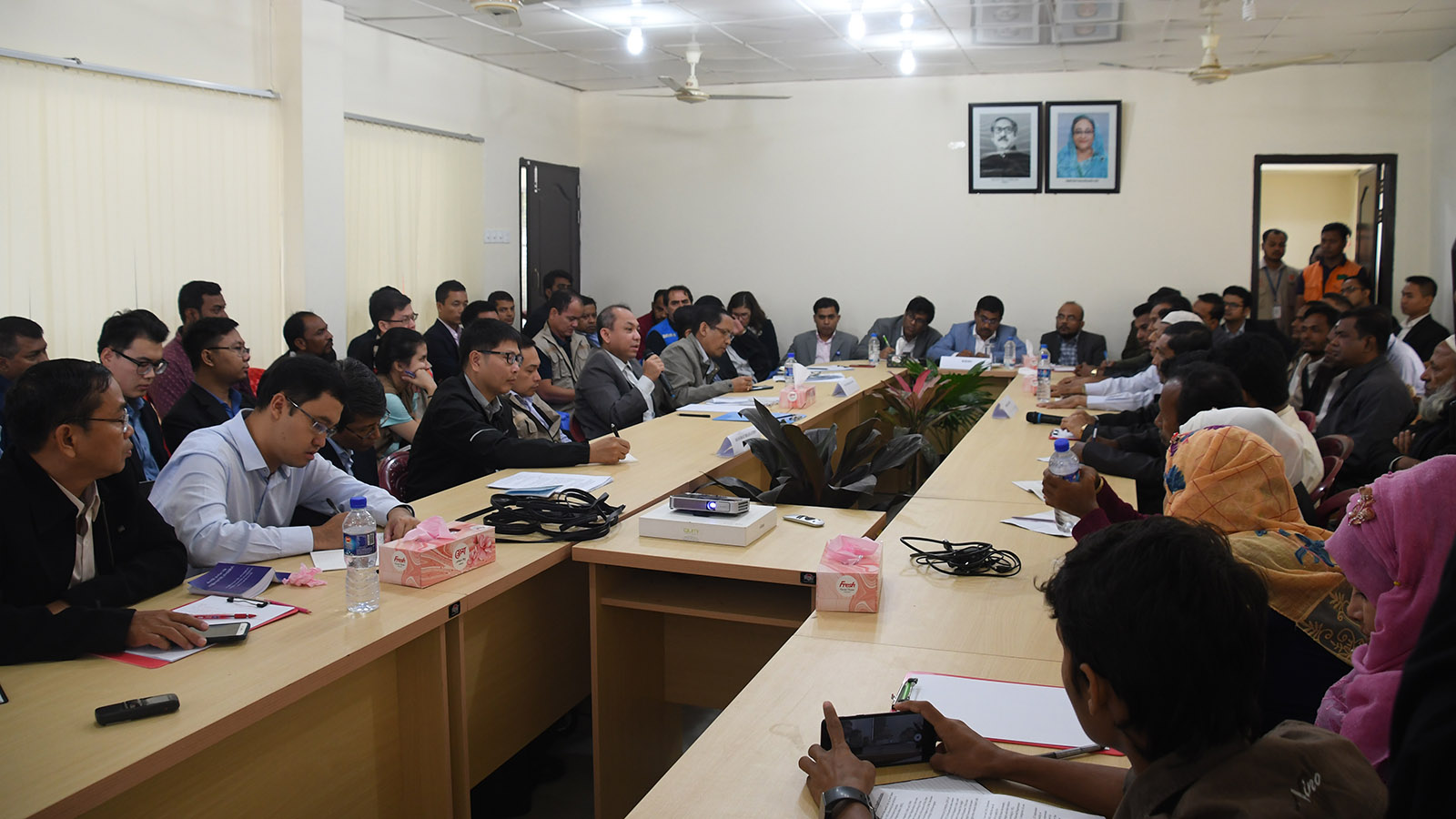 The Myanmar Delegation, accompanied by ASEAN-ERAT members, brief the displaced persons on the Government's efforts on repatriation process at the extension of Camp No 4 in Cox's Bazar.Photo: MNA