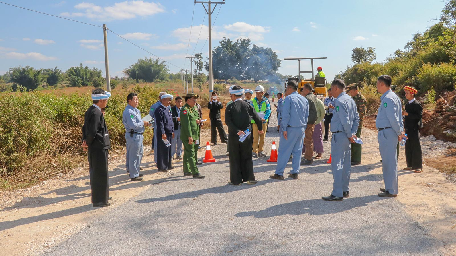 Union Minister Lt-Gen Ye Aung inspects the four-mile long concrete inter-village road in Pinlaung Township yesterday. Photo: MNA