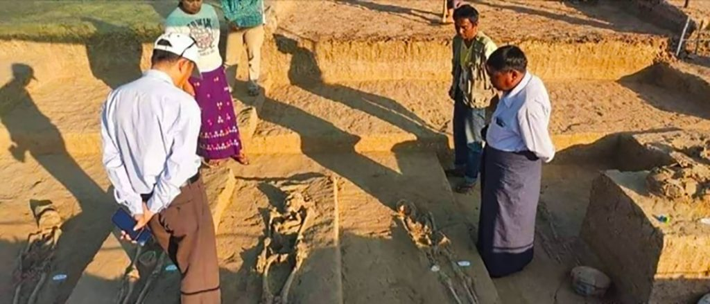 Officials check the human fossils on the site near the Yangon-Mandalay Highway. Photo: Township IPRD