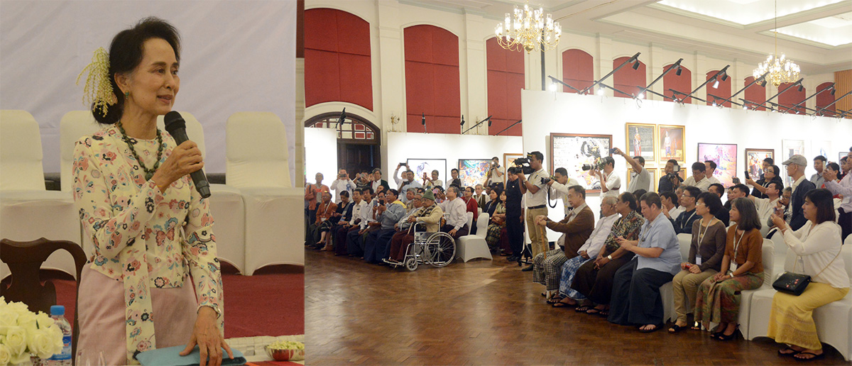 State Counsellor Daw Aung San Suu Kyi addresses the 'Hay Manda Art Exhibition' at the Strand Hotel in Yangon yesterday.Photo: MNA