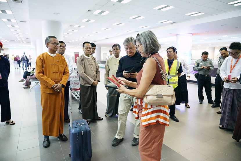 Union Minister U Ohn Maung, Deputy Minister U Tin Latt and officials observe the use of QR code by the tourists at the Mandalay TadaU Airport yesterday.Photo: MOHT