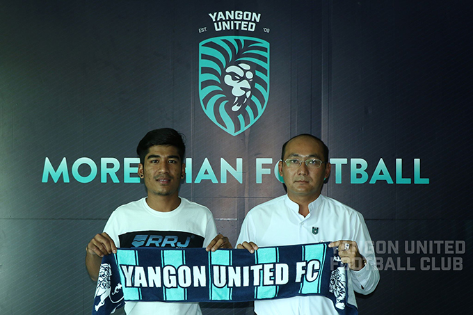 Striker Zin Min Tun holds the insignia of Yangon United FC upon his arrival to the team. Photo: MNL