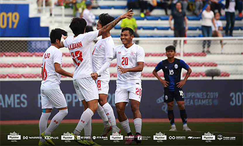 Myanmar players including Aung Kaung Mann (No.13) celebrate after scoring a goal in the 30th SEA Games at the Rizal Memorial Stadium in Manila on 10 December 2019. Photo: MFF