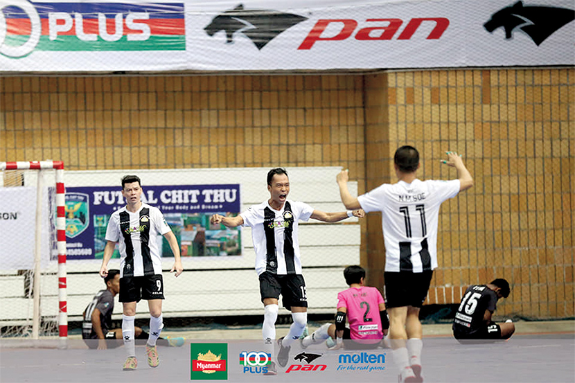Players from VUC futsal team celebrate their victory over GV FC in the Myanmar Futsal League match yesterday.Photo: MFF Futsal