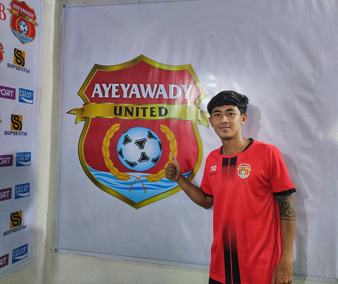 Youth midfielder Thaw Khant Oo poses with the Ayeyawady United logo upon joining the team. Photo: AUFC