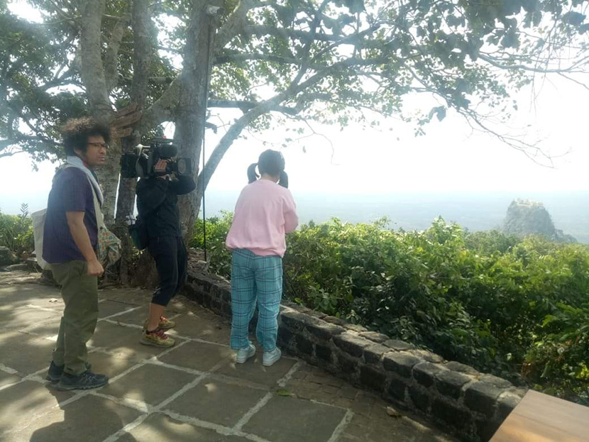 Japanese film crew from Tokyo Broadcasting System-TBS film the scenic view of Mount Popa from Popa Resort yesterday.Photo: Kyaw Swar Thein (FDC)