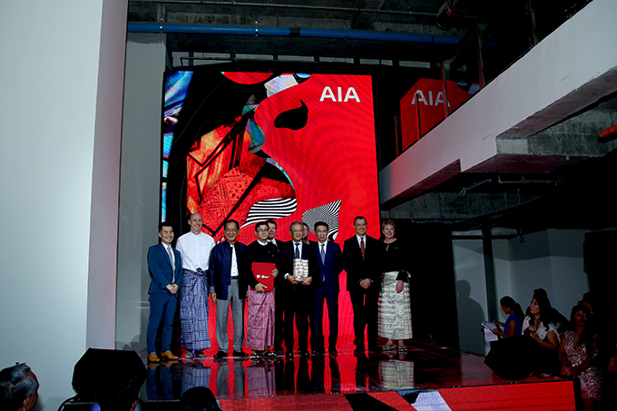 AIA Group Limited President Mr NG Keng Hooi, AIA Myanmar CEO Mr Nhon Ly (Luc) and attendees pose for a photo at the UN – Grand Opening event in Yangon.Photo: Supplied
