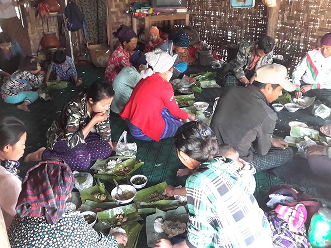Local people enjoy new harvest feast. Photo: Kaung Sithu