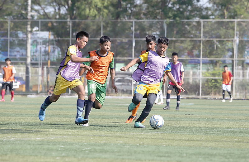 """Youths participating in the """"Road to Japan"""" football event in Yangon with their hope of Japan tour. Photo:MFF"""